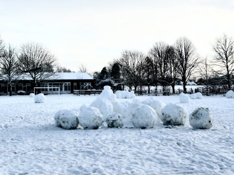 Goostrey School field in the snow with huge snowballs