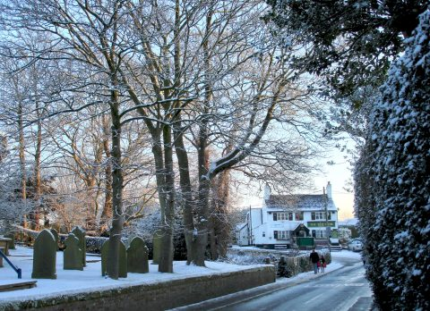 Winter scene of the graveyard and Red Lion in Goostrey