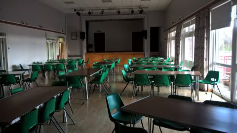 view of the Village Hall Main hall laid out with tables and chairs for a function
